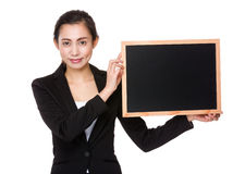 Young businesswoman hold with chalkboard Stock Photo