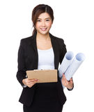 Young businesswoman hold with clipboard and blue print Royalty Free Stock Image