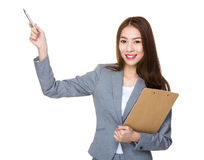 Young businesswoman hold with clipboard and pen up Stock Images