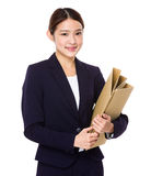 Young businesswoman hold with file pad Stock Photo