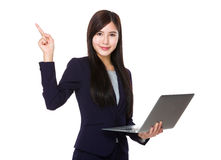 Young businesswoman hold with laptop computer and finger pointing up stock image