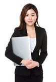 Young businesswoman hold with laptop computer Stock Photo