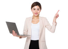 Young businesswoman hold with notebook computer and finger point Royalty Free Stock Photos