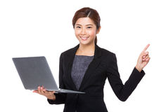 Young Businesswoman hold with notebook computer and finger point Stock Photo