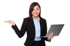 Young Businesswoman hold with notebook computer and hand showing Stock Photography