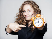 Young Businesswoman Holding A Clock Royalty Free Stock Images