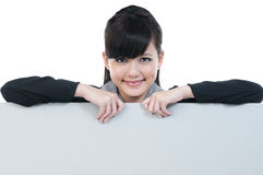 Young Businesswoman Holding Blank Billboard Royalty Free Stock Photography