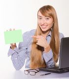 Young businesswoman holding a blank card Stock Photography