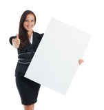 Young businesswoman holding at blank card in her hand Stock Image