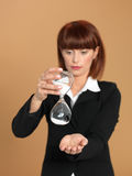 Young businesswoman holding broken hourglass Royalty Free Stock Photo