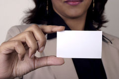 Young businesswoman holding Business card closeup Stock Photos