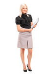 Young businesswoman holding a clipboard Stock Photo