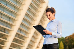 Young businesswoman holding clipboard. Stock Images