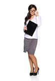 Young businesswoman holding clipboard Royalty Free Stock Photos