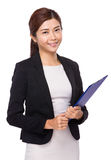 Young businesswoman holding with clipboard Stock Photo