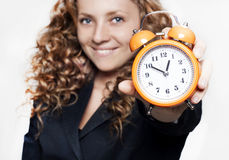 Young businesswoman holding a clock Royalty Free Stock Photos