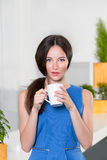 Young businesswoman holding a cup off coffee Stock Images