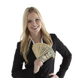 Young businesswoman holding currency notes Royalty Free Stock Image