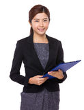Young businesswoman holding with document work Stock Photos