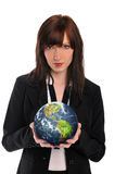 Young businesswoman holding the earth Stock Images