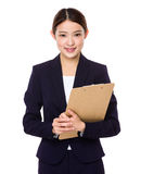 Young businesswoman holding with file pad Stock Photography