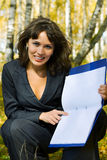Young businesswoman holding a folder. Stock Photography