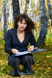 Young businesswoman holding a folder. Royalty Free Stock Photos