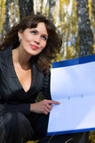 Young businesswoman holding a folder. Stock Image