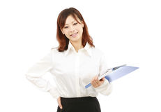 Young businesswoman holding a folder Royalty Free Stock Images