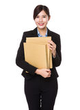 Young businesswoman holding with folder Royalty Free Stock Images