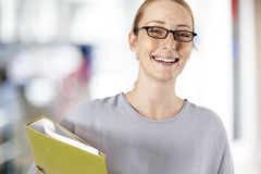 Young businesswoman holding folder Stock Images