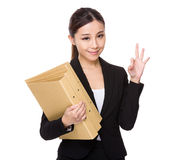 Young businesswoman holding with folder and ok sign gesture Stock Photo