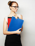 Young businesswoman holding folders Stock Image
