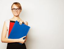 Young businesswoman holding folders Stock Images