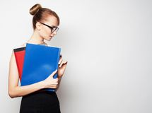 Young businesswoman holding folders Royalty Free Stock Photos
