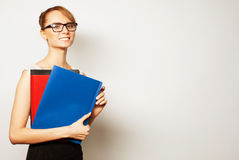 Young businesswoman holding folders Royalty Free Stock Images