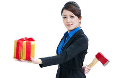 Young Businesswoman Holding Gift Box And Axe Stock Photography