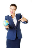 Young businesswoman holding globe Stock Photo
