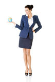 Young businesswoman holding globe Royalty Free Stock Images