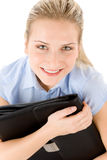 Young businesswoman holding handbag Stock Photo