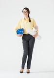 Young businesswoman holding a helmet and projects Stock Photos