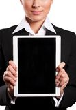 A young businesswoman holding her digital tablet pc (white backg Stock Photo