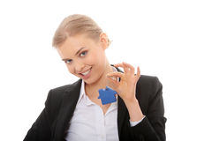 Young businesswoman holding house shaped key chain Stock Images