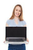 Young businesswoman holding laptop Stock Images