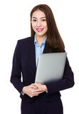 Young businesswoman holding with laptop computer Stock Image