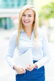 Young businesswoman holding laptop Stock Image