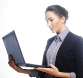 Young businesswoman holding a laptop Royalty Free Stock Images