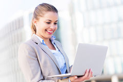 Young businesswoman holding laptop Royalty Free Stock Photography