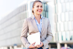 Young businesswoman holding laptop Stock Photos