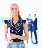 Young businesswoman holding a laptop, standing on office Royalty Free Stock Photos